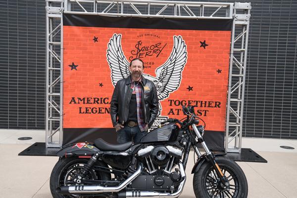 Oliver Peck with Harley Davidson