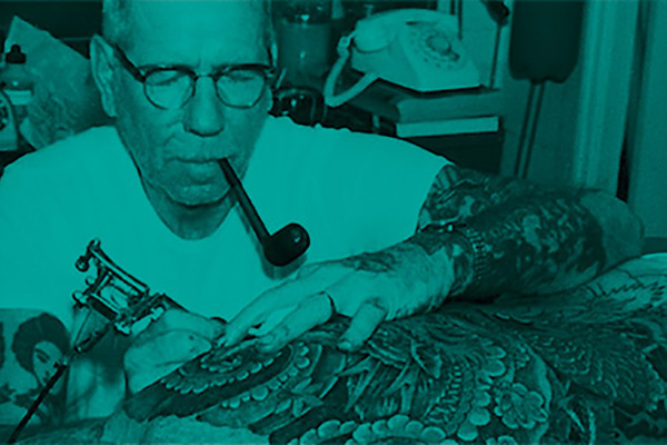 "Norman ""Sailor Jerry"" Collins at work in his tattoo parlour"